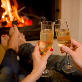 Champagne in front of the wood burning stove